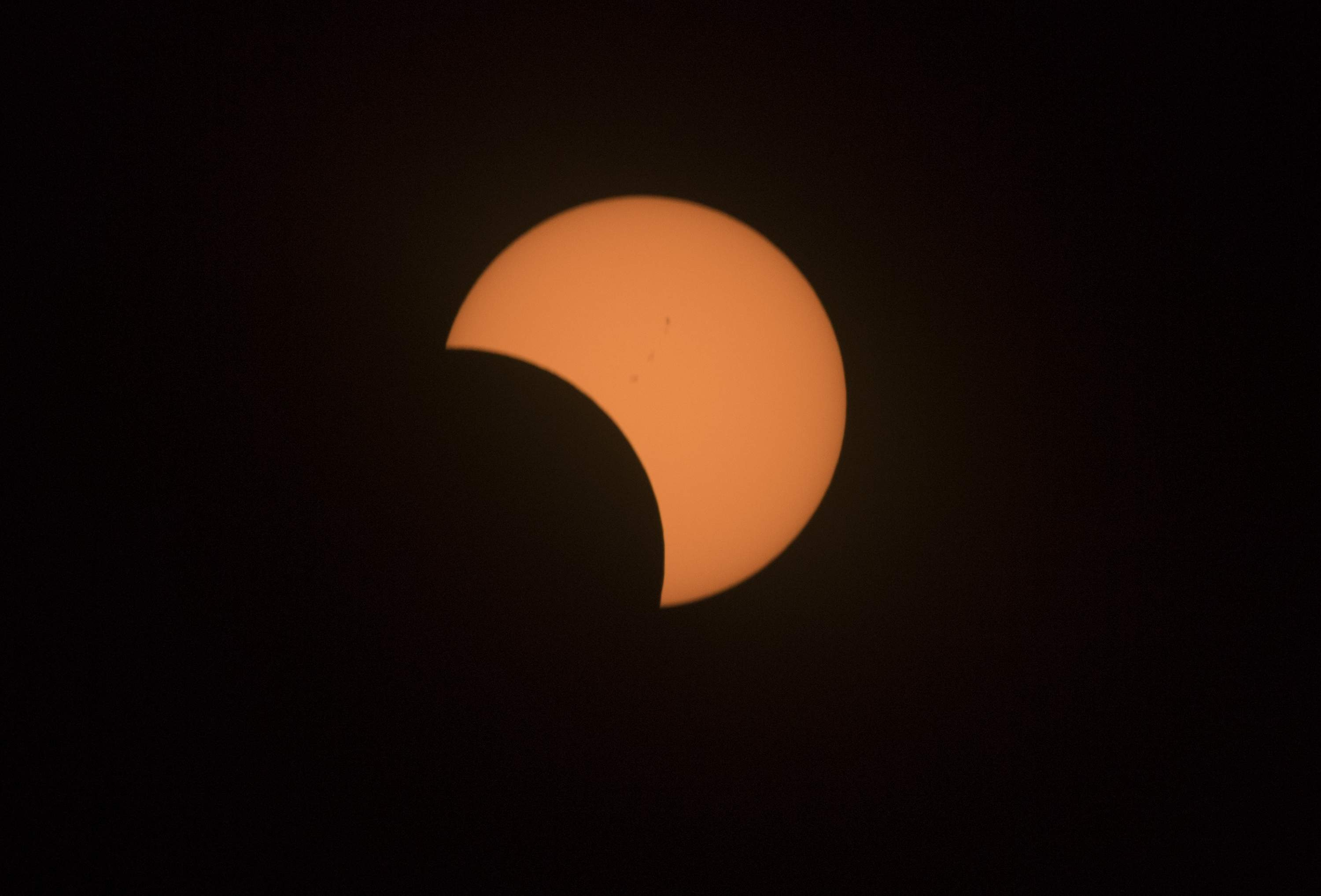 The partial solar eclipse wanes at about 11 a.m. in Stockton. [CLIFFORD OTO/THE RECORD]