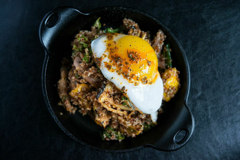Quality Athletics' Quinoa Salad with duck leg confit, charred fennel, and sunny side egg. (Image: Sarah Flotard)