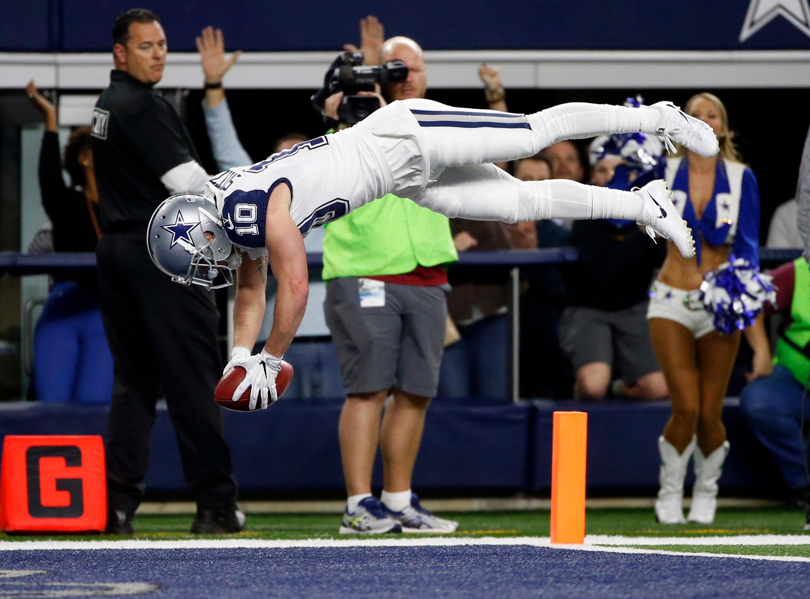 Dallas Cowboys wide receiver Ryan Switzer (10) leaps into the end zone after returning a Washington Redskins punt for a touchdown in the first half of an NFL football game, Thursday, Nov. 30, 2017, in Arlington, Texas. (AP Photo/Ron Jenkins)