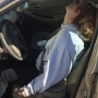 Police share photo of woman overdosing in a parking lot with baby in backseat of car