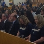 Dozens gather for a Day of Remembrance service on the eve of the Kalamazoo shooting