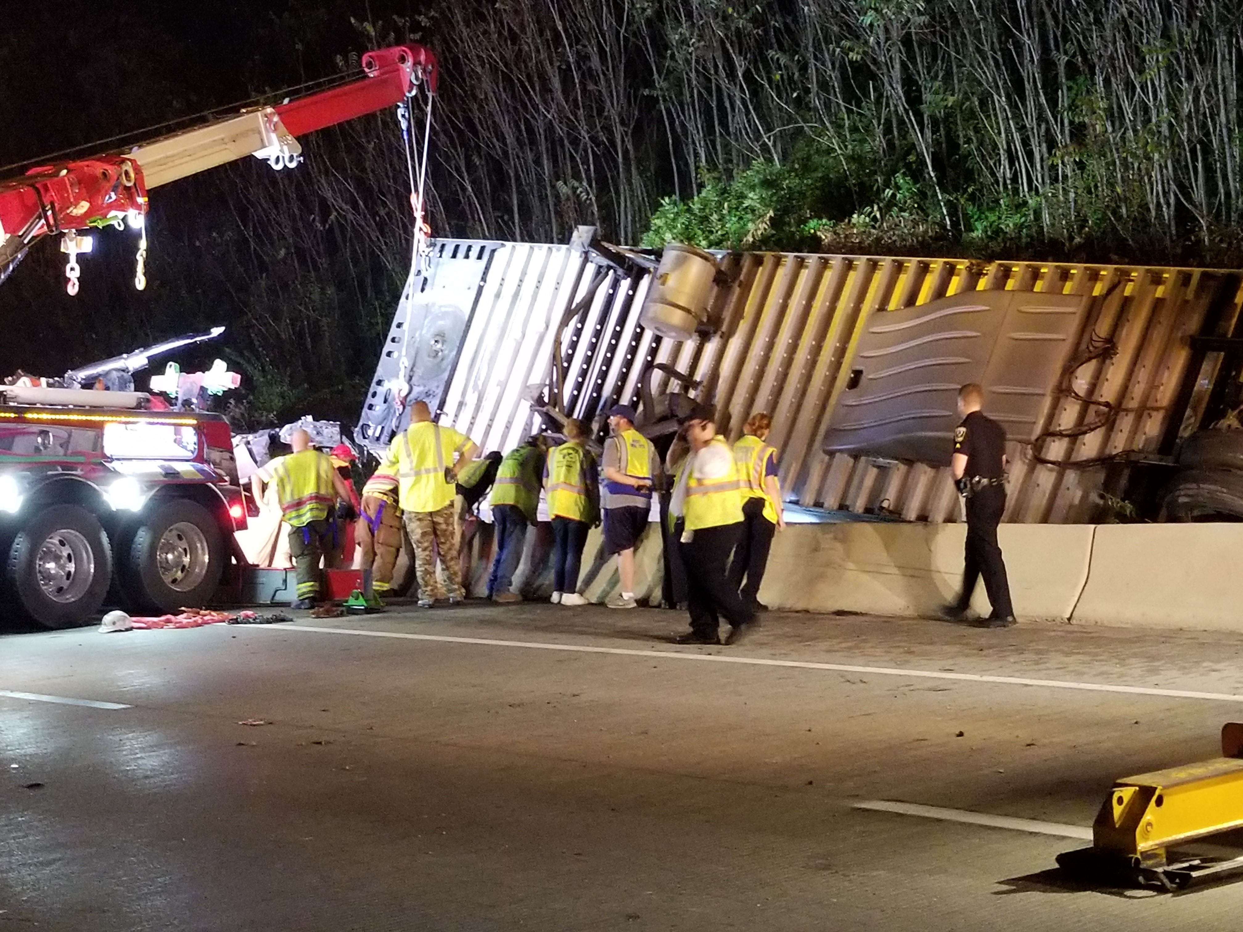 Police said a tractor-trailer flipped over the edge of the bridge near mile marker 54 late Tuesday night. (WCHS/WVAH)<p></p>