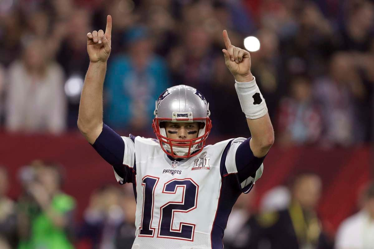 New England Patriots' Tom Brady raises his arms after a touchdown, during the second half of the NFL Super Bowl 51 football game against the Atlanta Falcons, Sunday, Feb. 5, 2017, in Houston. (AP Photo/Darron Cummings)