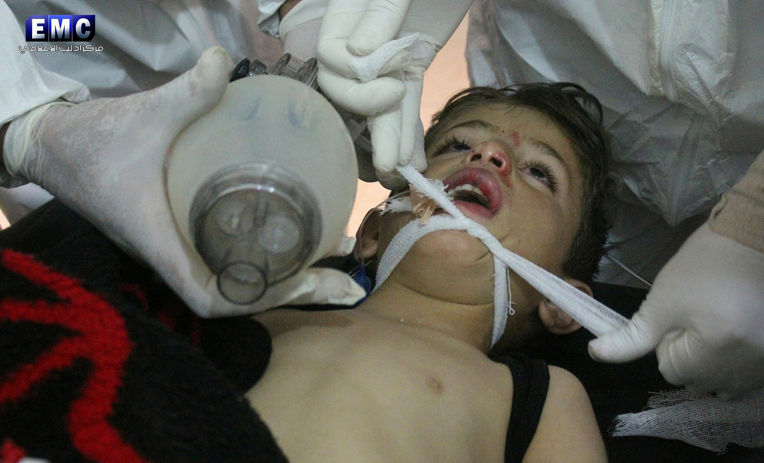 FILE -- In this Tuesday, April 4, 2017 file photo, provided by the Syrian anti-government activist group Edlib Media Center, which has been authenticated based on its contents and other AP reporting, shows Syrian doctors treating a child following a suspected chemical attack, at a makeshift hospital, in the town of Khan Sheikhoun, northern Idlib province, Syria. Turkey's health minister, Recep Akdag, said Tuesday, April 11, 2017, that test results conducted on victims of the chemical attack in Khan Sheikhoun confirm that sarin gas was used. (Edlib Media Center, via AP, File)