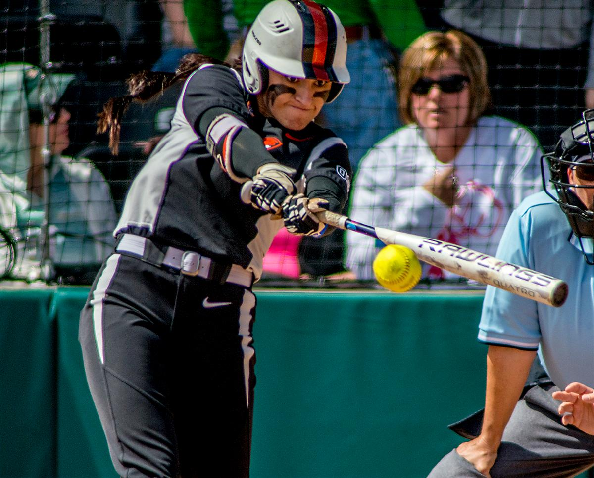 The Beavers' Shelby Weeks (#20) connects with the ball. The Oregon Ducks defeated the Oregon State Beavers 7-2 in game two of the three-game Civil War series at Jane Sanders Stadium on Saturday. The final game of the series will be on Sunday at 3:00 p.m. at Jane Sanders Stadium. Photo by August Frank, Oregon News Lab