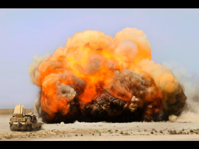 U.S. Marines use M1 assault vehicles to employ mine-clearing charges with rockets to detonate emplaced mines prematurely nearby Camp Leatherneck in Afghanistan's Helmand province, April 29, 2014. The Mariness are assigned to 1st Combat Engineers Battalion