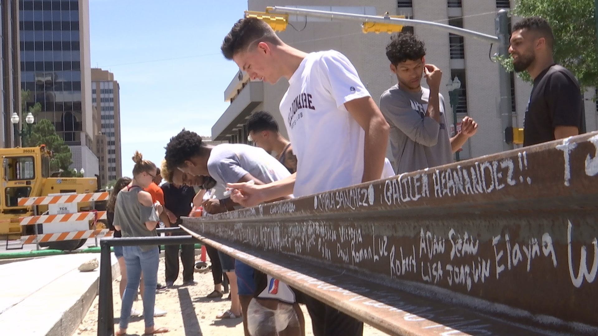 People got the opportunity to sign their name on the last piece of rail to be laid down for the Streetcar Project. (Credit: CBS4/KFOX14)