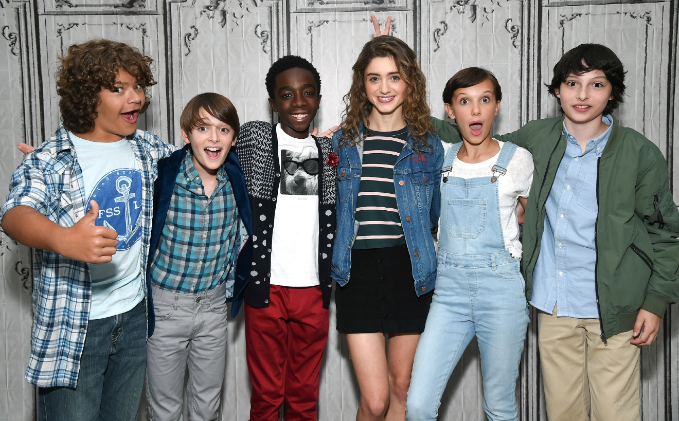 "Actors from left to right, Gaten Matarazzo, left, Noah Schnapp, Caleb McLaughlin, Natalia Dyer, Millie Bobby Brown and Finn Wolfhard participate in the BUILD Speaker Series to discuss the Netflix series, ""Stranger Things"", at AOL Studios on Wednesday, Aug. 31, 2016, in New York. (Photo by Evan Agostini/Invision/AP)"