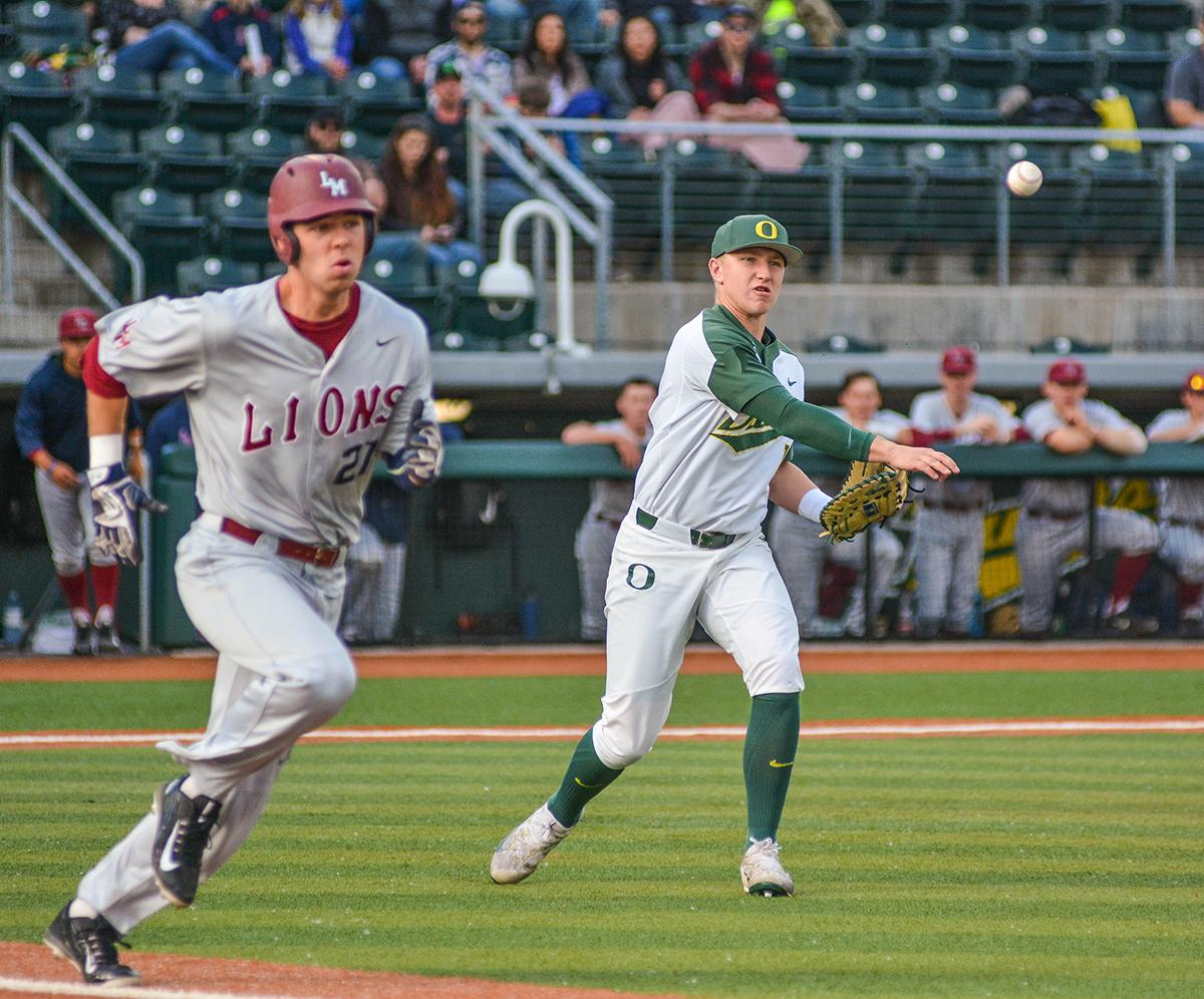 Ducks Gabe Mathews (#12) throws out Lions Kevin Jordan (#27). On Wednesday night the Ducks fell to the Loyola Marymount Lions 4-0 at PK Park. Photo by Jacob Smith, Oregon News Lab