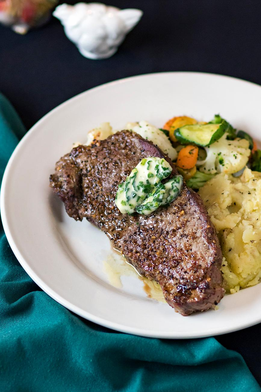 <p>NY Strip Steak with mashed potatoes and seasonal vegetables / Image: Allison McAdams // Published: 5.23.19</p>