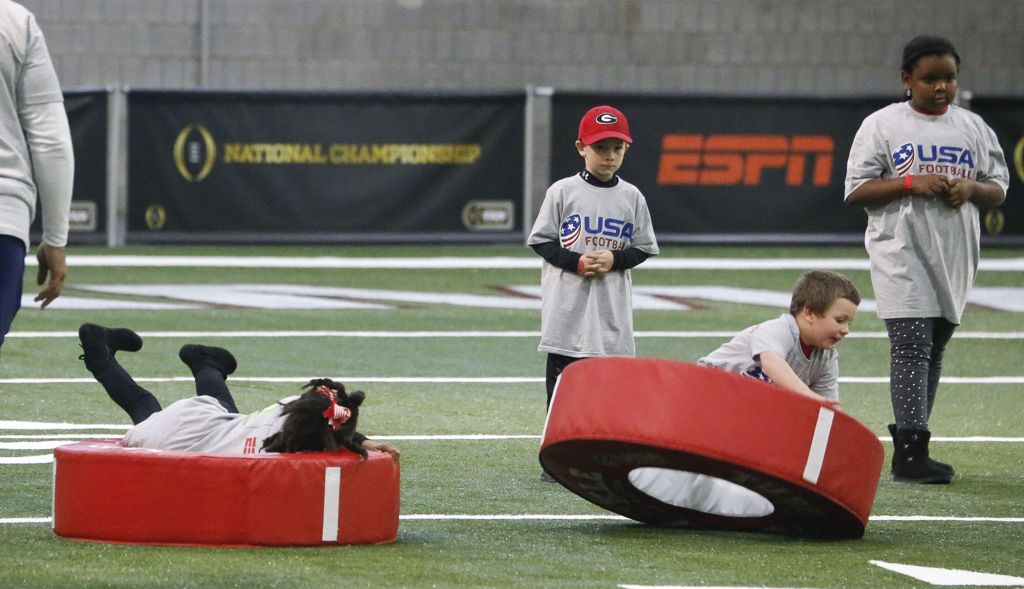 Kids enjoy interactive football activities as Alabama and Georgia fans enjoy activities at the Georgia World Congress Center Sunday, Jan. 7, 2018. [Gary Cosby Jr./The Tuscaloosa News]