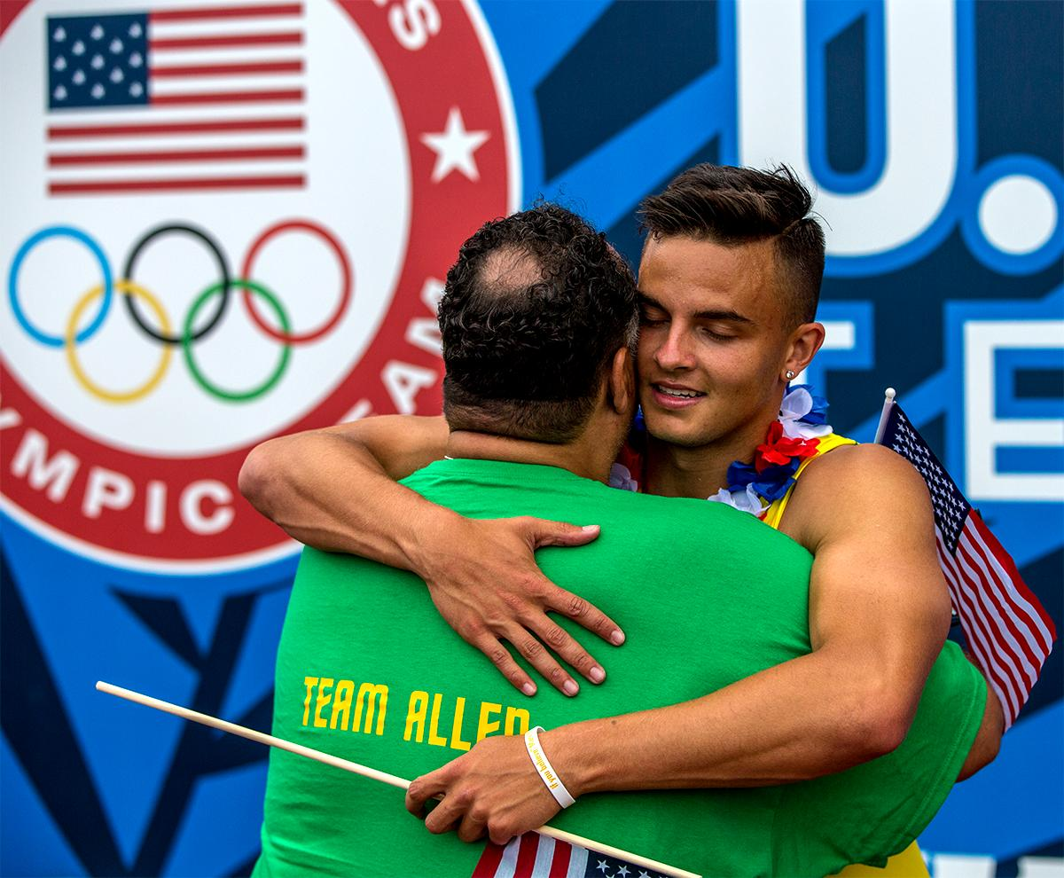 Oregon's Devon Allen hugs his father Louis after winning the 110 meter hurdles in 13.03. Photo by August Frank, Oregon News Lab