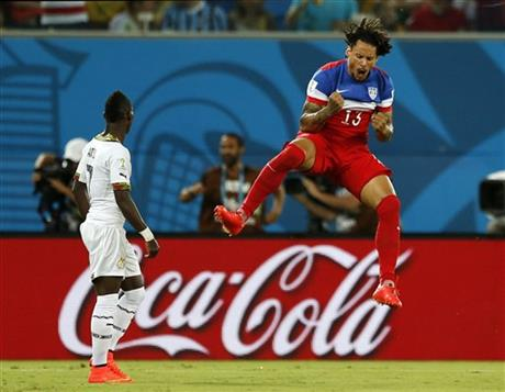 United States' Jermaine Jones celebrates a goal by Clint Dempsey during the group G World Cup soccer match between Ghana & the United States at the Arena das Dunas in Natal, Brazil, Monday, June   16, 2014.
