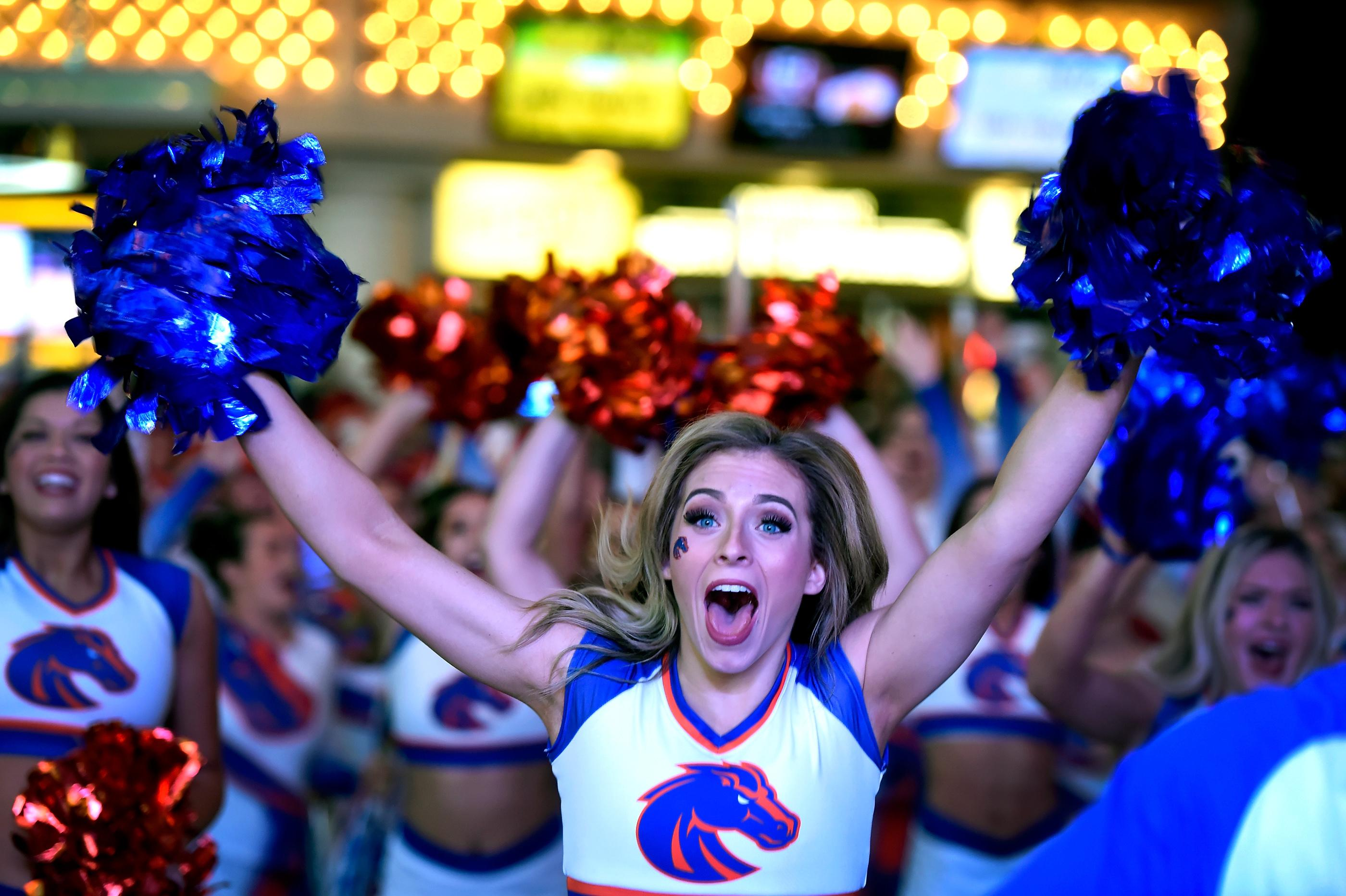 Boise State cheerleader Chelsea Borlase participates during a pep rally at the Fremont Street Experience Friday, Dec. 15, 2017, in Las Vegas. The Boise State Bronco will take on the Oregon Ducks in the 26th edition of the Las Vegas Bowl at Sam Boyd Stadium on Saturday. CREDIT: David Becker/Las Vegas News Bureau