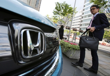 Honda posts quarterly profit on lower recall costs