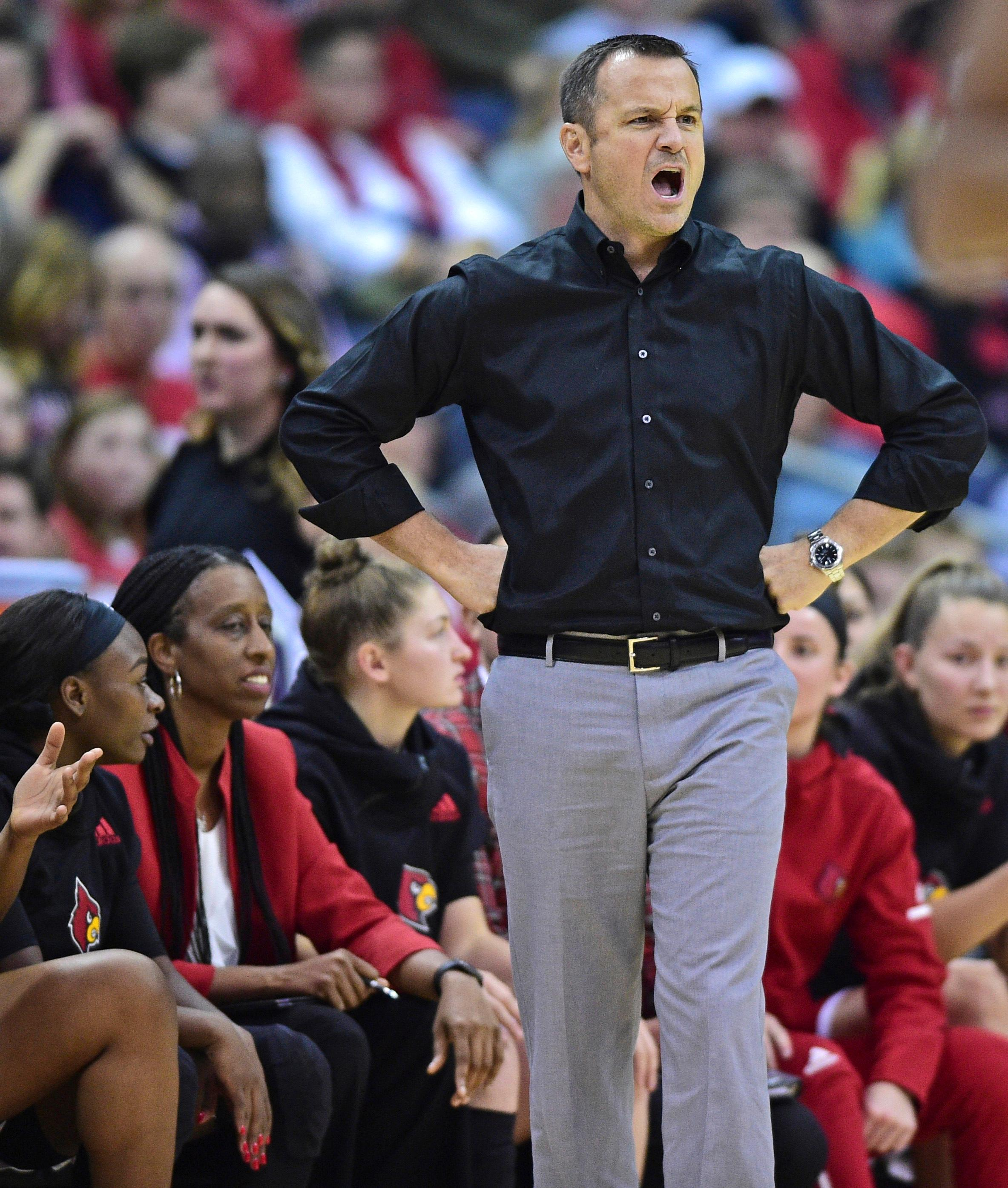 Louisville head coach Jeff Walz shouts during the first quarter of an NCAA college basketball game against Ohio State, Sunday, Nov. 12, 2017, in Columbus, Ohio. (AP Photo/David Dermer)