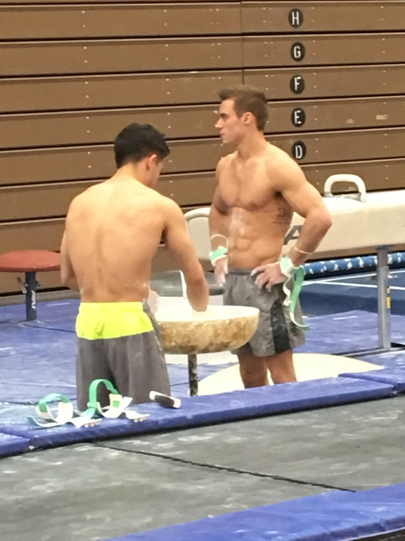 SamMikulak (right) during training at the Olympic Training Center in Colorado Springs, Colorado speaking with a USA Gymnastics teammate.  Photo Credit: Sadie Hughes.