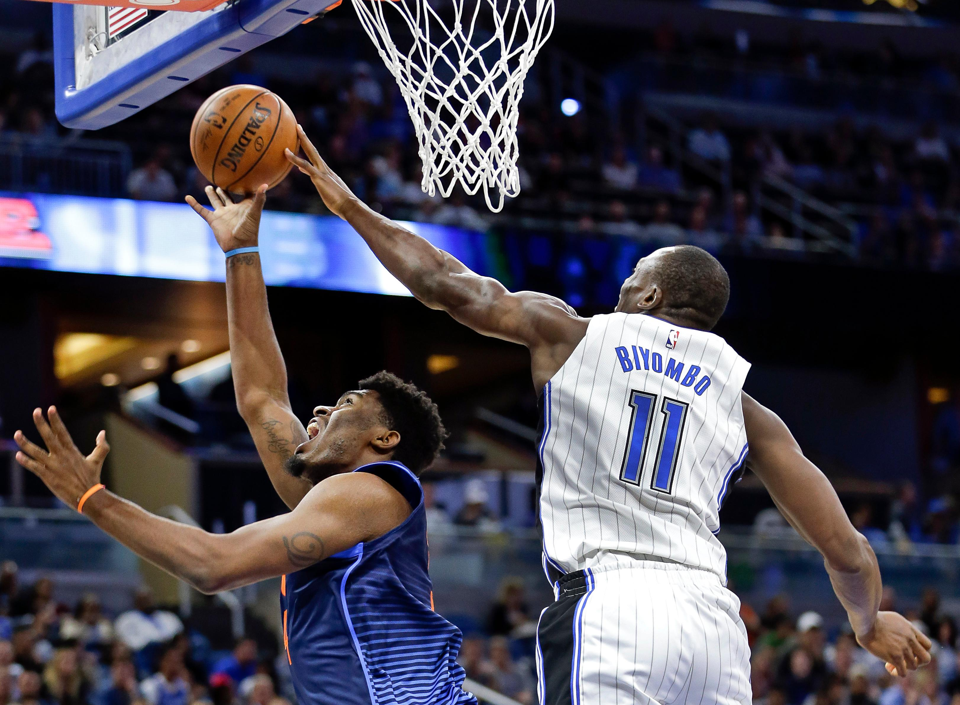 Orlando Magic's Bismack Biyombo (11) blocks a shot attempt by Oklahoma City Thunder's Dakari Johnson during the first half of an NBA basketball game, Wednesday, Nov. 29, 2017, in Orlando, Fla. (AP Photo/John Raoux)