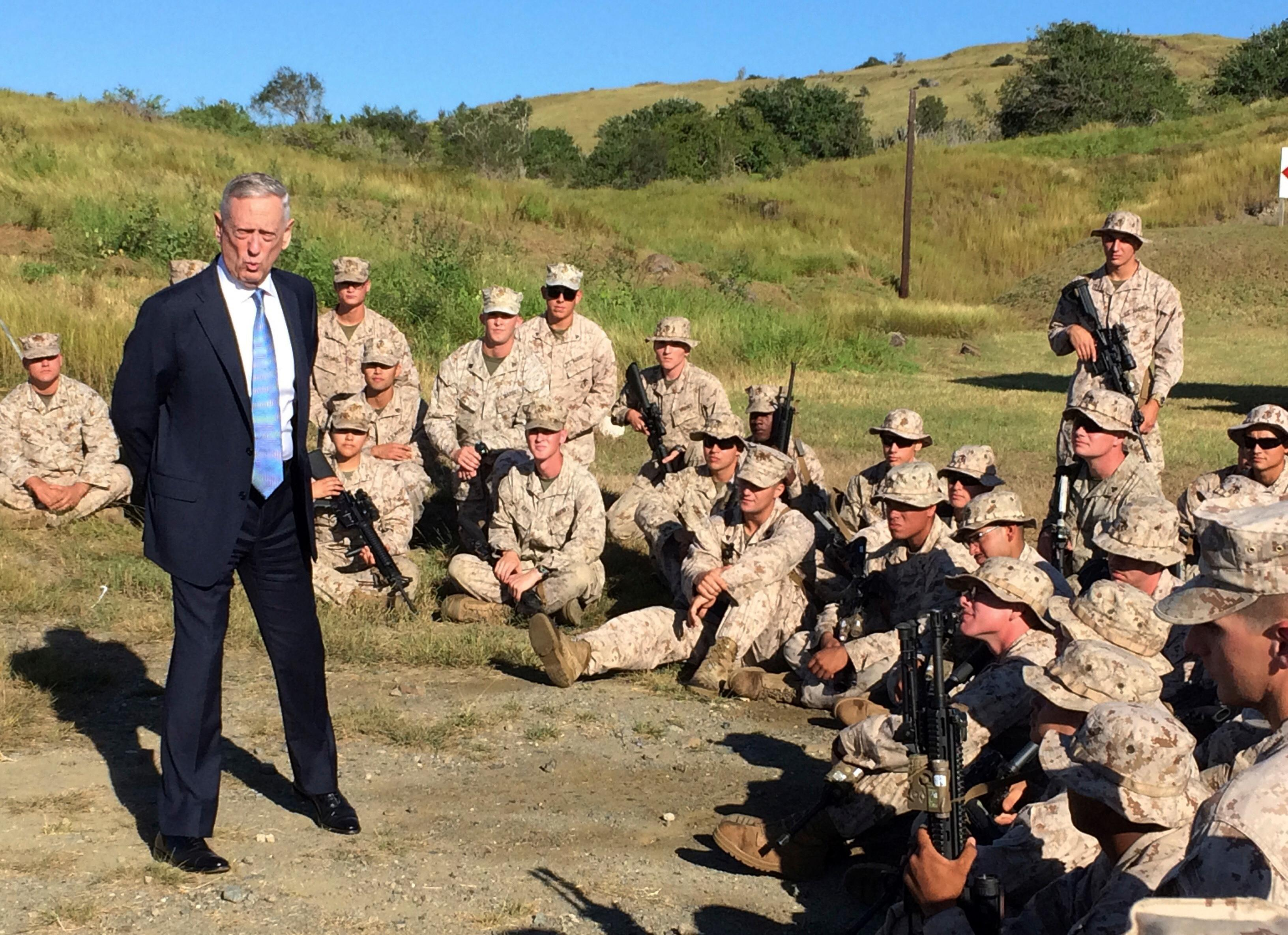 FILE - In this Dec. 21. 2017, file photo, Defense Secretary Jim Mattis talks to U.S. Marine Corps troops at a rifle range at Guantanamo Bay, Cuba. For only the second time since 9/11, America's defense secretary didn't visit U.S. troops in a war zone during December, breaking a longstanding tradition of personally and publicly thanking service members in combat who are separated from their families during the holiday season. (AP Photo/Robert Burns, File)