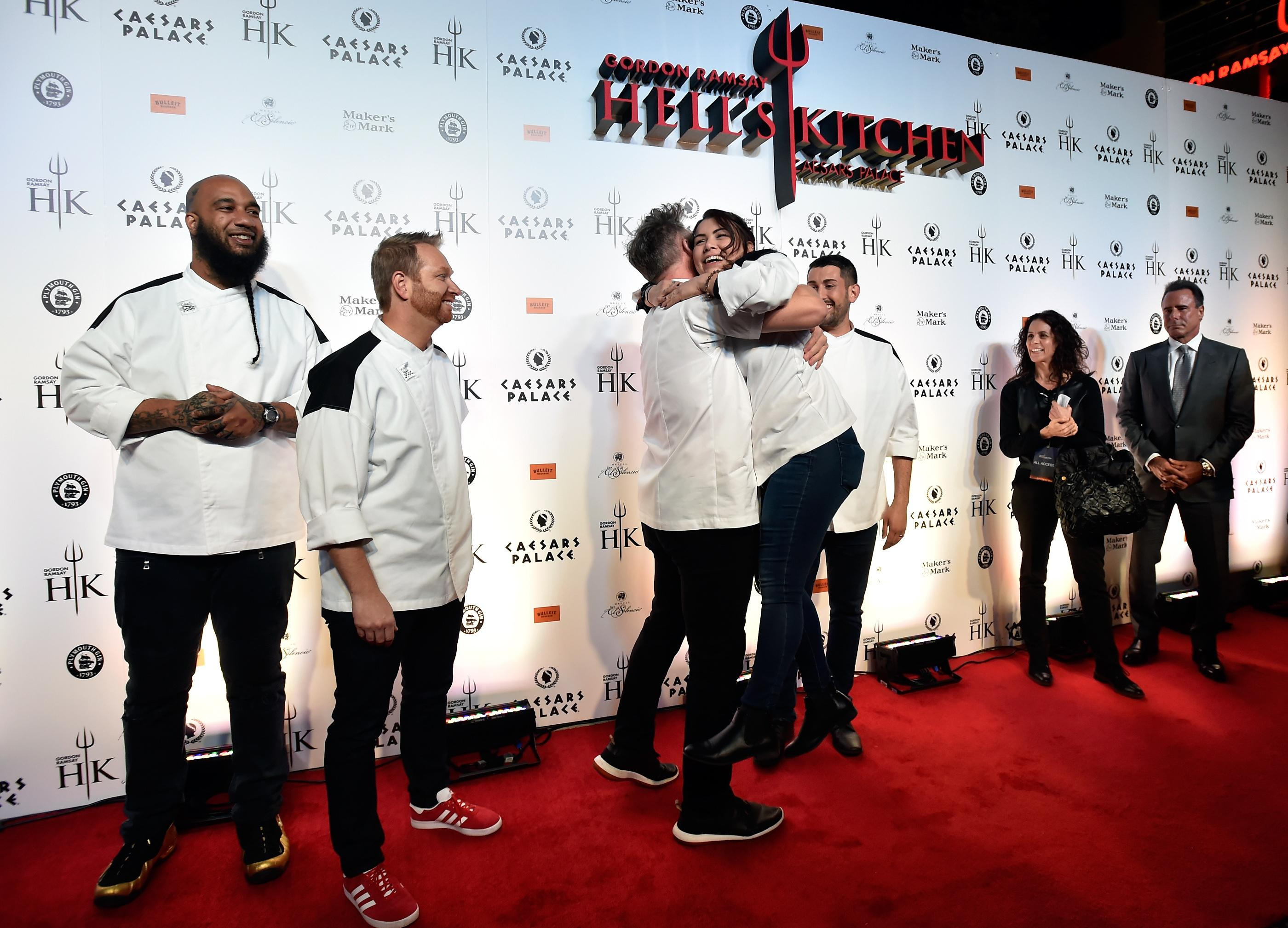 Chef Gordon Ramsay, 3rd left, greets Hell's Kitchen season 17 finalist Michelle Tribble during the grand opening red carpet of Gordon Ramsay Hell's Kitchen at Caesars Palace Friday, Jan. 26, 2018, in Las Vegas. CREDIT: David Becker/Las Vegas News Bureau