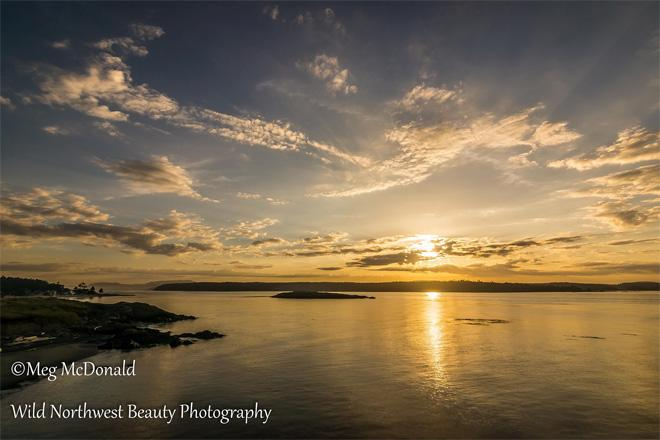A beautiful June sunrise over Lopez Island, captured recently from Cattle Point on San Juan Island. Photo credit: Wild Northwest Beauty Photography)