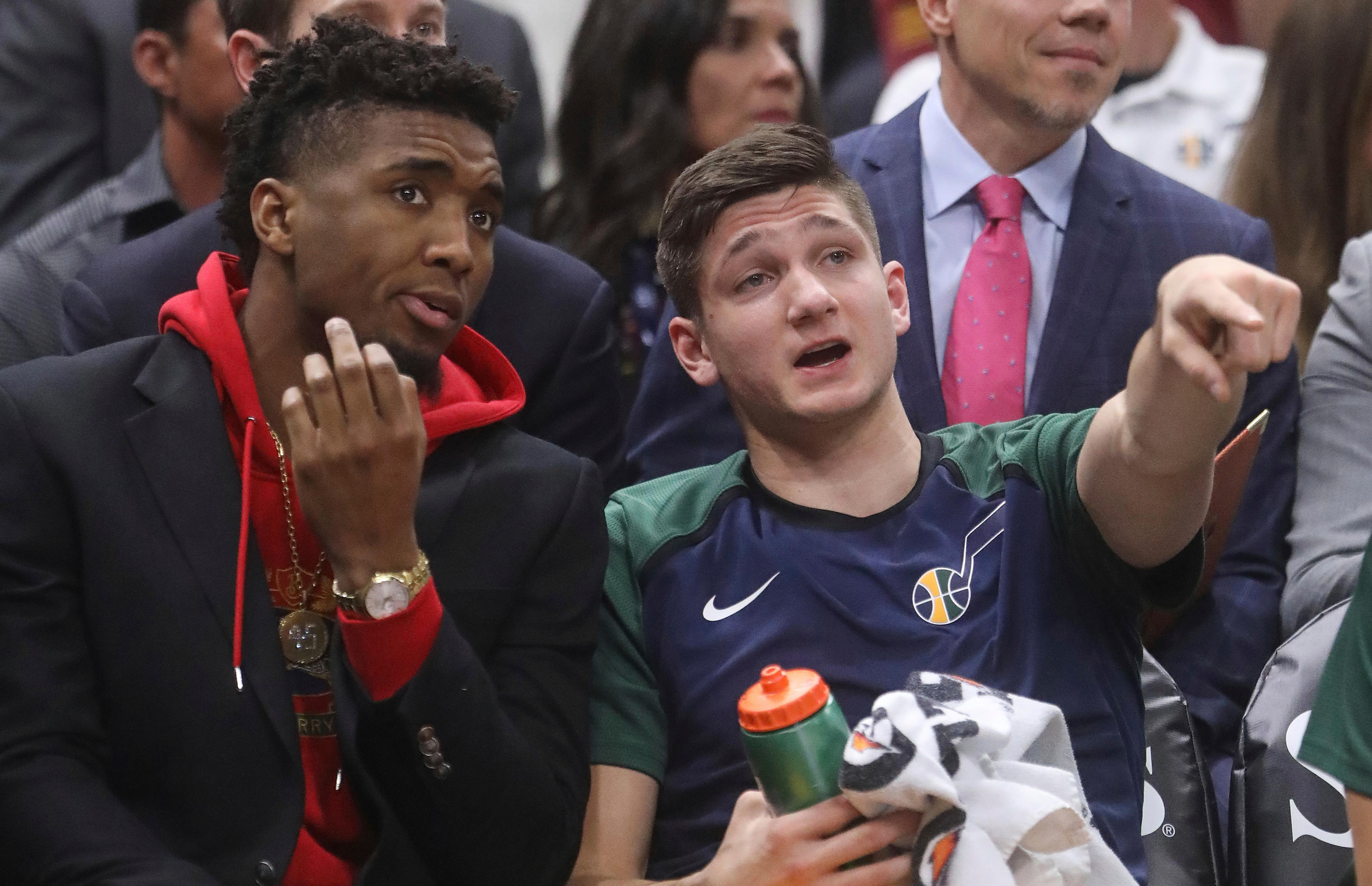 Utah Jazz's Donovan Mitchell, left, speaks with Grayson Allen, right, after he sits on the bench in the first half during an NBA basketball game against the Toronto Raptors Monday, Nov. 5, 2018, in Salt Lake City. (AP Photo/Rick Bowmer)