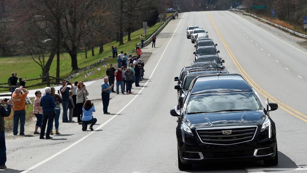 Somber farewell as Billy Graham procession leaves Asheville for Charlotte