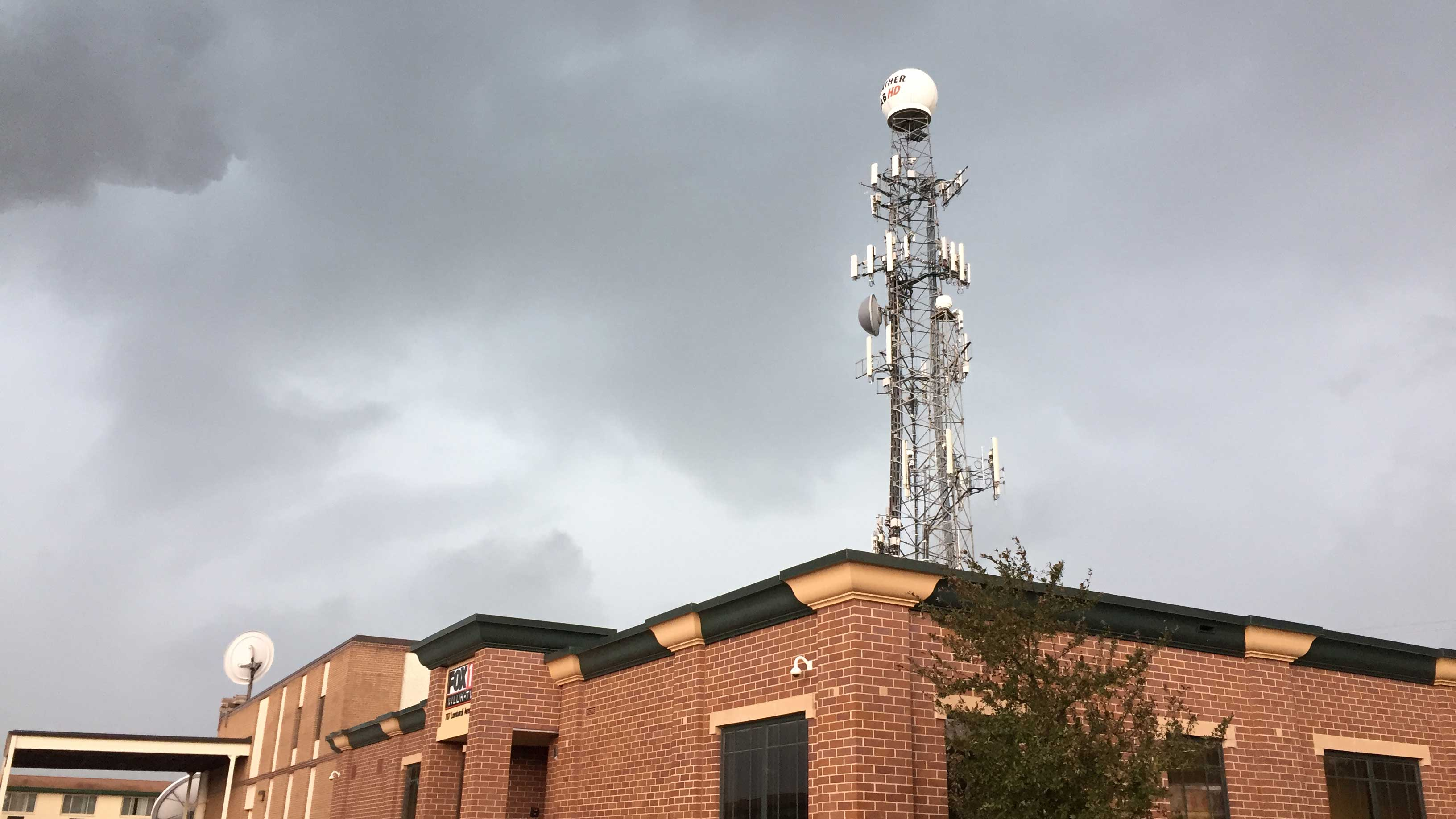 Dark clouds surround FOX 11's radar tower in Ashwaubenon June 14, 2017. (WLUK/Scott Hurley)