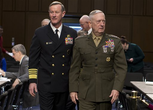 Marine Gen. James Mattis, commander, U.S. Central Command, right, followed by Navy Adm. William McRaven, commander, U.S. Special Operations Command, arrive on Capitol Hill in Washington, Tuesday, March 5, 2013, to testify before the Senate Armed Services Committee hearing to review of the Defense Authorization Request for Fiscal Year 2014 and the Future Years Defense Program. (AP Photo/Evan Vucci)