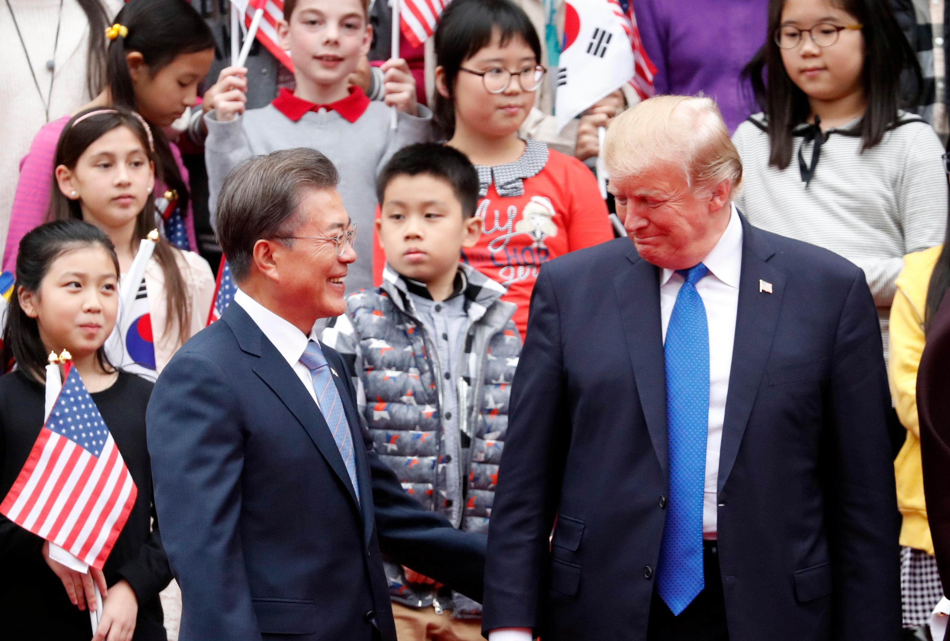 U.S. President Donald Trump, right, and South Korea's President Moon Jae-in attend a welcoming ceremony at the Presidential Blue House in Seoul Tuesday, Nov. 7, 2017. (Kim Hong-ji/Pool Photo via AP)