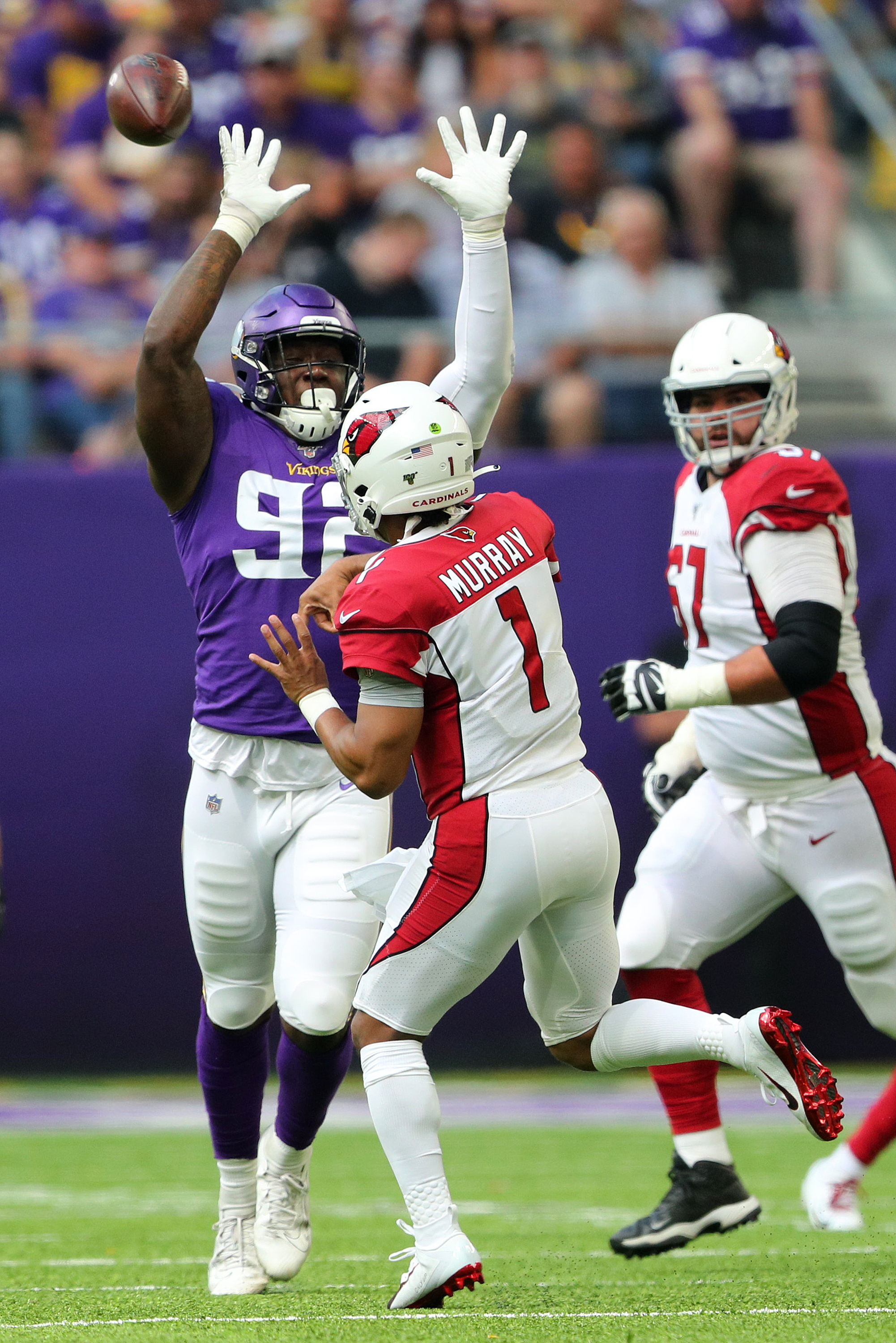 MINNEAPOLIS, MN - AUGUST 24: Jalyn Holmes #92 of the Minnesota Vikings attempts to block the pass of Kyler Murray #1 of the Arizona Cardinals in the second quarter of pre-season play at U.S. Bank Stadium on August 24, 2019 in Minneapolis, Minnesota. (Photo by Adam Bettcher/Getty Images)