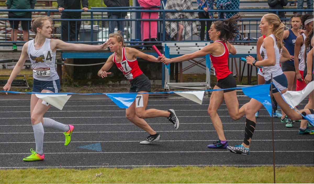 McKenna Miller, Jaelynne Birkby,. Tara Crosswhite and Rhianna Brown from Thurston High School wins the Women's 4 X 400m Relay event with the time of 4:10.75 at the 5A-3 Midwestern League District Track Championship. Photo by Vannie Cooper, Oregon News Lab