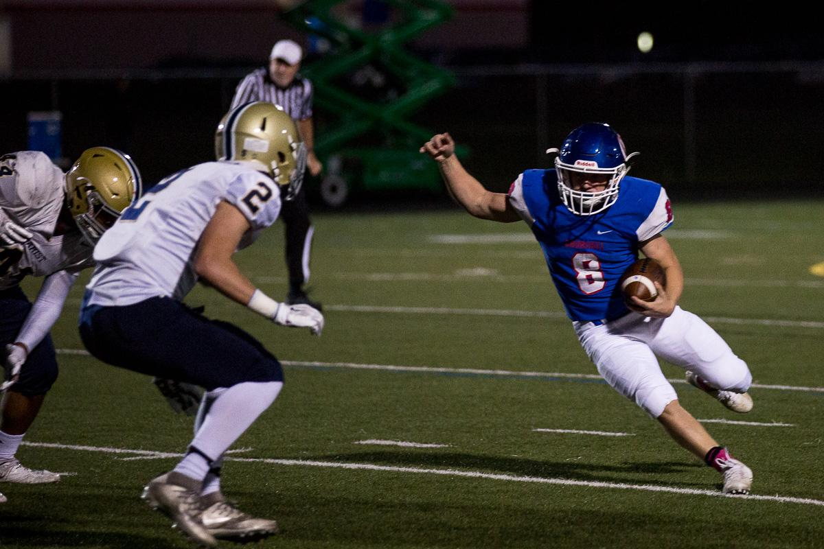 Churchill Lancers running back Dalton McDaniel (#8) attempts to outmaneuver Marist's defense. The Churchill Lancers defeated the Marist Catholic Spartans 41 - 20 at Churchill High School on Friday, October 6. Photo by Kit MacAvoy, Oregon News Lab