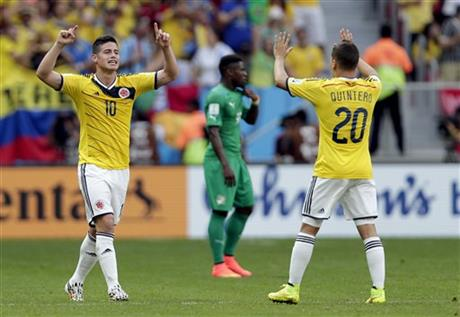 Colombia's James Rodriguez (10) celebrates with Juan Quintero (20) after scoring his side's opening goal during the group C World Cup soccer match between Colombia and Ivory Coast at the Estadio Nacional in Brasilia, Brazil, Thursday, June 19, 2014.
