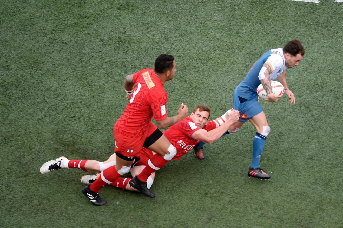 France's Terry Bouhraoua tries to get past Canada's Phil Berna and Mike Fuailefau during their match at the USA Sevens rugby tournament Saturday, March 4, 2017, at Sam Boyd Stadium. [Sam Morris/Las Vegas News Bureau]